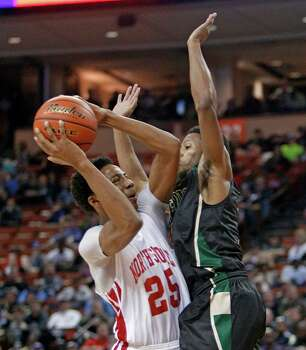 Galena Park North Shore guard Jarrey Foster (25) goes up for a shot against DeSoto guard Takedrick Brown during a boys' UIL Class 5A state basketball semifinal, Friday, March 7, 2014, in Austin, Texas. (AP Photo/Michael Thomas) Photo: Michael Thomas, Associated Press / FR65778 AP
