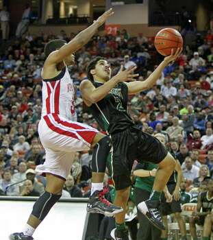 DeSoto guard Julian Miranda (2) lays up the ball against Galena Park North Shore guard Brandon Green during a boys' UIL Class 5A state basketball semifinal on Friday, March 7, 2014, in Austin, Texas. (AP Photo/Michael Thomas) Photo: Michael Thomas, Associated Press / FR65778 AP