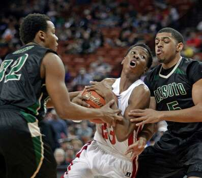 Galena Park North Shore guard Kerwin Roach, center, drives against DeSoto guards Julian Green, left, and Dominique Thomas, right, during a boys' UIL Class 5A state basketball semifinal, Friday, March 7, 2014, in Austin, Texas. (AP Photo/Michael Thomas) Photo: Michael Thomas, Associated Press / FR65778 AP