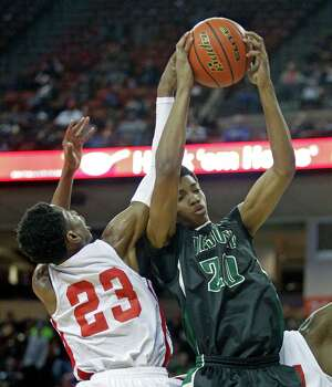 DeSoto forward Devin Wyatt (20) brings down a rebound against Galen Park North Shore guard Kerwin Roach (23) during a boy's UIL Class 5A state basketball semifinal, Friday, March 7, 2014, in Austin, Texas. (AP Photo/Michael Thomas) Photo: Michael Thomas, Associated Press / FR65778 AP
