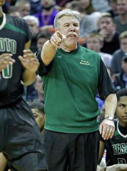 DeSoto boy's head coach Chris Dyer directs his team against Galena Park North Shore during a boy's UIL Class 5A state basketball semifinal, Friday, March 7, 2014, in Austin, Texas. (AP Photo/Michael Thomas) Photo: Michael Thomas, Associated Press / FR65778 AP