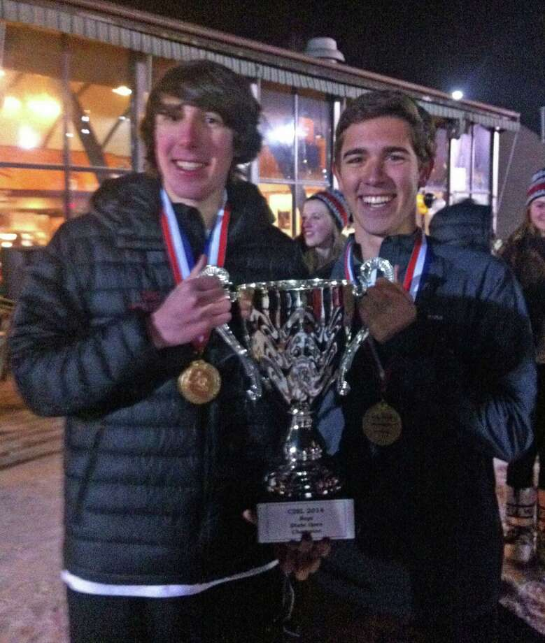 Greenwich High ski team captainsr Zach Moran, left, and Federico Mato pose with the state championship trophy. Photo: Contributed Photo / Greenwich Time Contributed