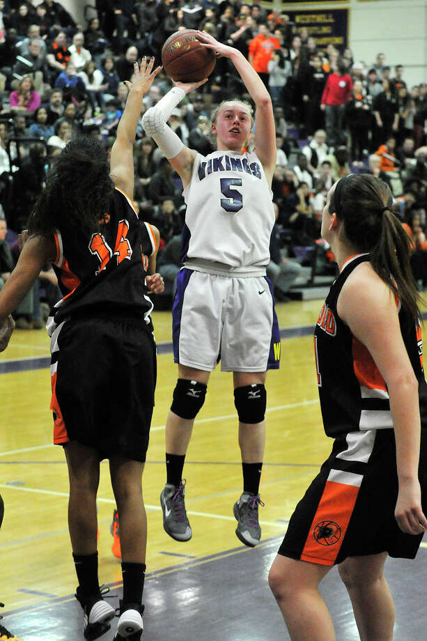 Westhill's Steph Roones shoots over Stamford's Brianna Gordon during their Class LL basketball game at Westhill High School in Stamford, Conn., on Thursday, March 6, 2014. Westhill won, 45-28. Photo: Jason Rearick / Stamford Advocate