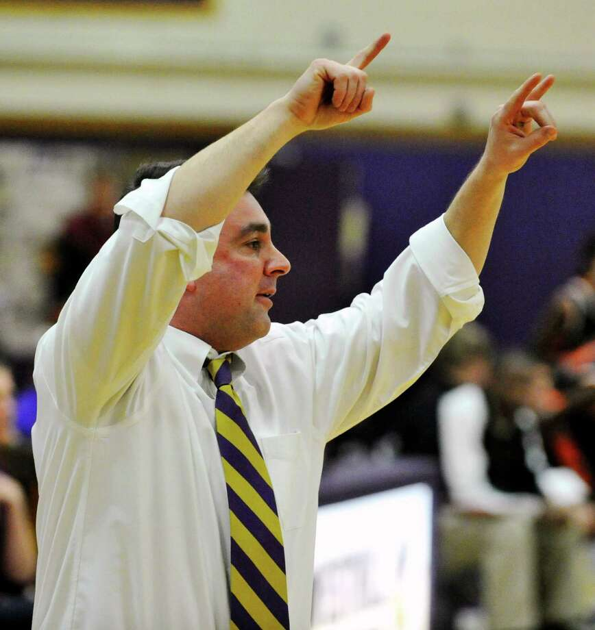 Westhill head coach Mike King shouts orders to his team during their Class LL basketball game against Stamford at Westhill High School in Stamford, Conn., on Thursday, March 6, 2014. Westhill won, 45-28. Photo: Jason Rearick / Stamford Advocate