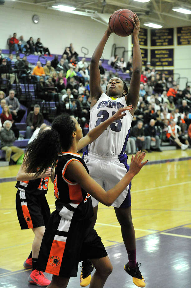 Westhill's Krystal Dixon snares a rebound away from Stamford players during their Class LL basketball game at Westhill High School in Stamford, Conn., on Thursday, March 6, 2014. Westhill won, 45-28. Photo: Jason Rearick / Stamford Advocate