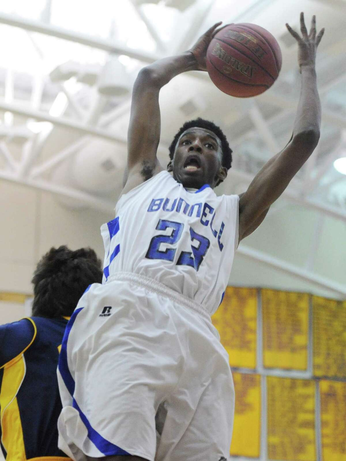 Bunnell's Issac Vann (23) grabs a rebound in No. 2 Bunnell's 46-45 overtime win over No. 3 Weston in the SWC boys basketball semifinal game at Newtown High School in Newtown, Conn. Tuesday, March 4, 2014.