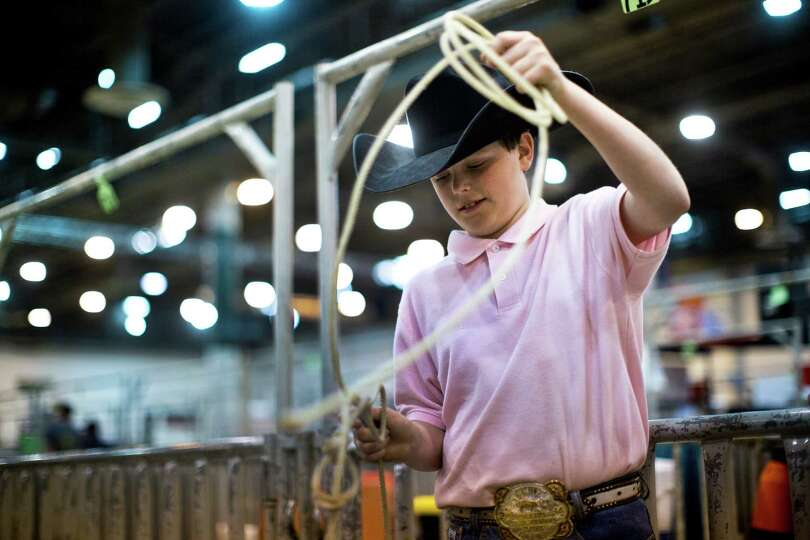 Jacob Norwood, 10, of Valleyview, plays with a lasso at Reliant Center during the Houston Livestock