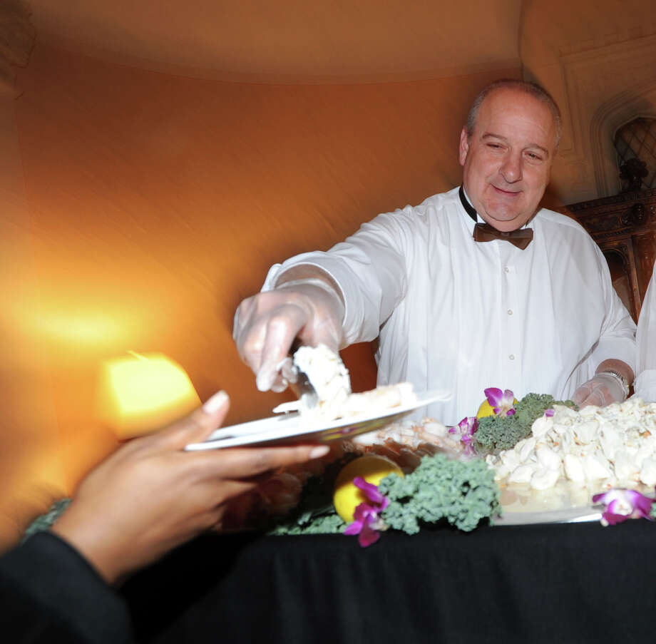 Joe Bruno of ShopRite Supermarket serves up the jumbo shrimp during the Greenwich Hospital annual Great Chefs fundraiser at the Westchester Country Club in Rye, N.Y., Friday night, March 7, 2014. Photo: Bob Luckey / Greenwich Time