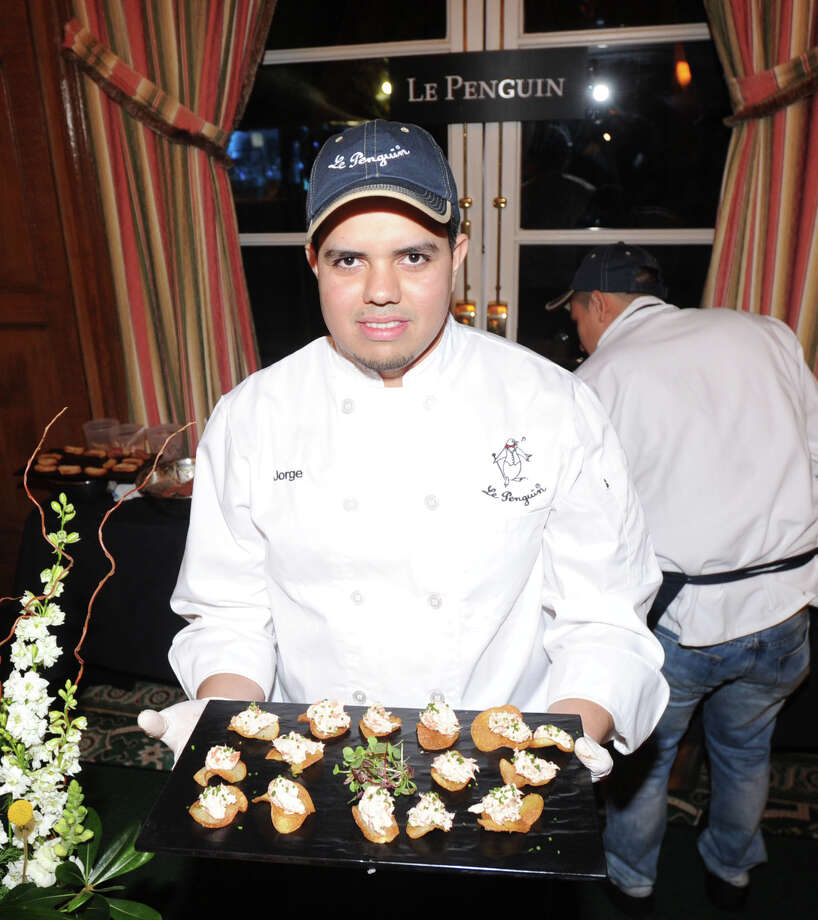 Chef Jorge Escobar of Le Penguin Bistro of Greenwich displays Salmon Rilletes on toasted bread during the Greenwich Hospital annual Great Chefs fundraiser at the Westchester Country Club in Rye, N.Y., Friday night, March 7, 2014. Photo: Bob Luckey / Greenwich Time