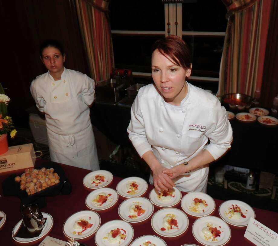 At right, Chef Amanda Atkinson of Morello Italian Bistro of Greenwich, serves Yogurt Panna Cotta during the Greenwich Hospital annual Great Chefs fundraiser at the Westchester Country Club in Rye, N.Y., Friday night, March 7, 2014. Photo: Bob Luckey / Greenwich Time