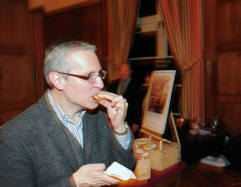Daniel Suozzo of Rye, N.Y., samples a Greenwich Hospital Restaurant slider during the Greenwich Hospital annual Great Chefs fundraiser at the Westchester Country Club in Rye, N.Y., Friday night, March 7, 2014. Photo: Bob Luckey / Greenwich Time