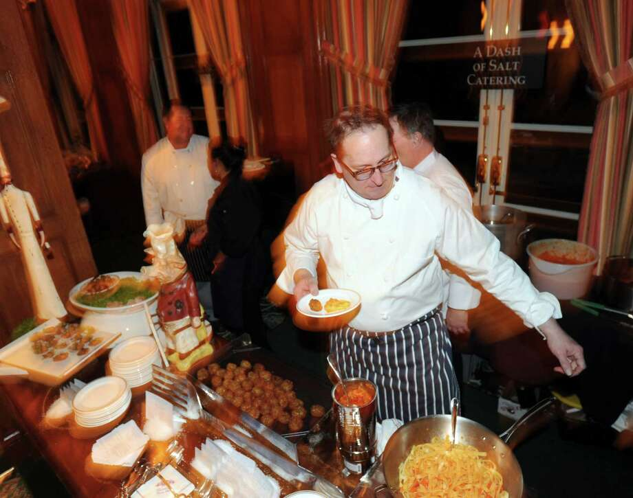 Dash of Salt Chef Jonathan Mathias, right, in action during the Greenwich Hospital annual Great Chefs fundraiser at the Westchester Country Club in Rye, N.Y., Friday night, March 7, 2014. Photo: Bob Luckey / Greenwich Time