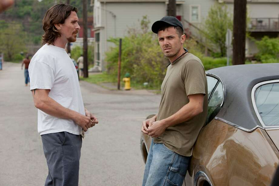 "Christian Bale (left) and Casey Affleck star in ""Out of the Furnace,"" out this week on DVD and Blu-ray. Photo: Kerry Hayes, Associated Press"