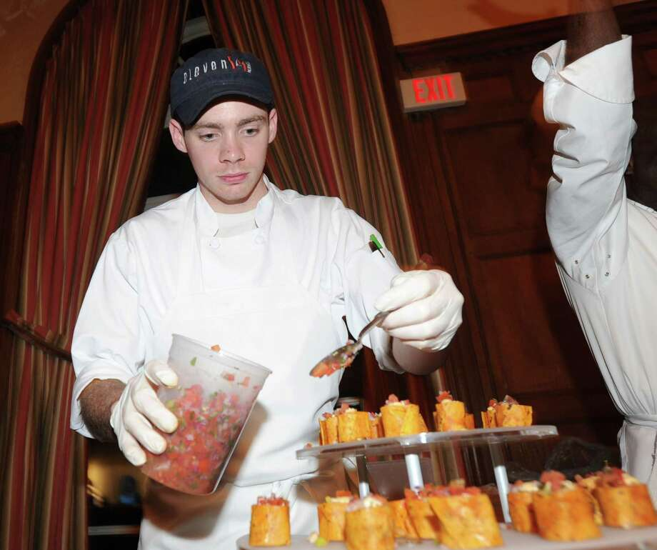 Conor Horton of The J House, prepares a dish prior to the start of the Greenwich Hospital annual Great Chefs fundraiser at the Westchester Country Club in Rye, N.Y., Friday night, March 7, 2014. Photo: Bob Luckey / Greenwich Time