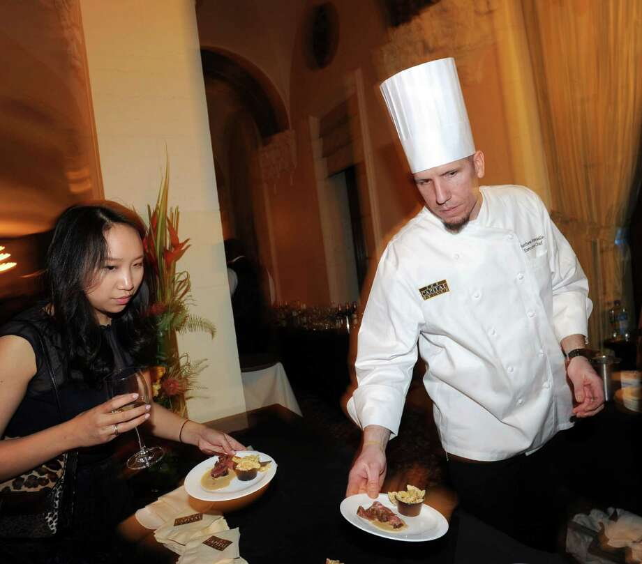 At right, Capital Grille Chef, Matthew Schmalle, serves coffee crusted sirloin during the Greenwich Hospital annual Great Chefs fundraiser at the Westchester Country Club in Rye, N.Y., Friday night, March 7, 2014. Photo: Bob Luckey / Greenwich Time