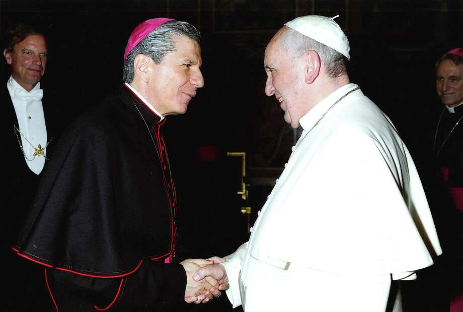 San Antonio's Archbishop Gustavo García-Siller is greeted by the pontiff during the bishops meeting at the Vatican.