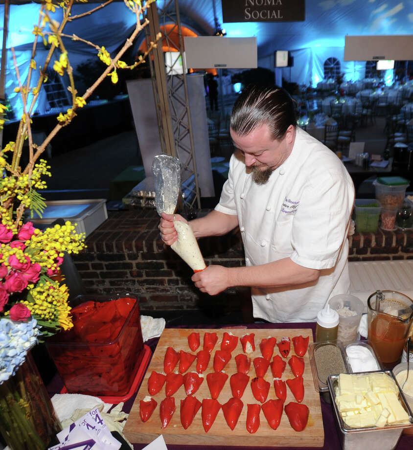 Chef Bill Rosenberg of NoMa in New Rochelle, N.Y., finishes up preparations for a crab and pepper diish during the Greenwich Hospital annual Great Chefs fundraiser at the Westchester Country Club in Rye, N.Y., Friday night, March 7, 2014. Photo: Bob Luckey / Greenwich Time