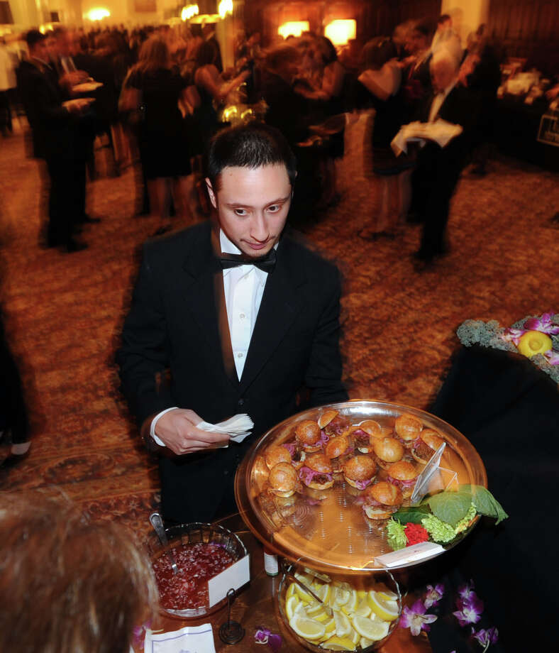 Alex Salzmann of the Greenwich Hospital Restaurant serves coffee pulled-pork sliders during the Greenwich Hospital annual Great Chefs fundraiser at the Westchester Country Club in Rye, N.Y., Friday night, March 7, 2014. Photo: Bob Luckey / Greenwich Time