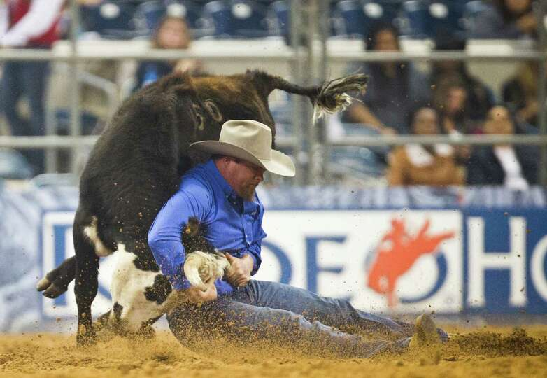 Stan Branco competes in the BP Super Series II Round 1 Steer Wrestling competition during Houston Li