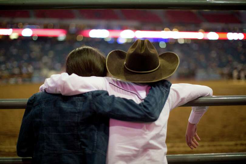Charles Barrier, right, 11, and his sister Mattie, 12, watch the Rodeo Houston Grand Entry during th