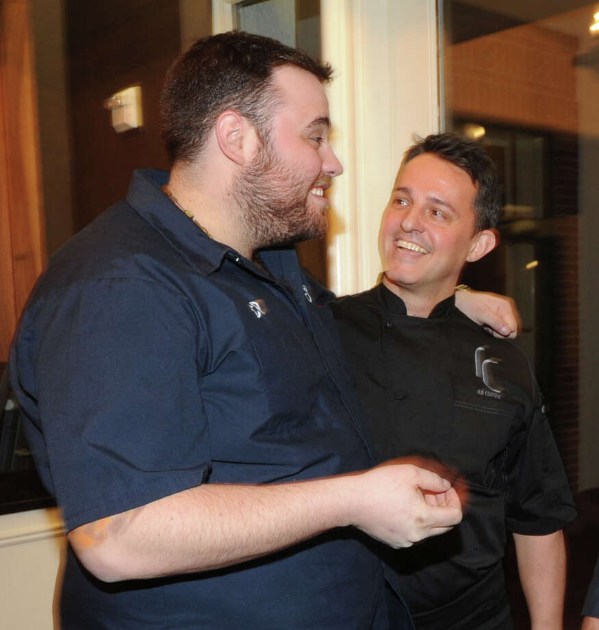 Chefs, Christian Petroni (left) of Fortina in Armonk, N.Y., and Rui Correia of Douro Restaurant Bar in Greenwich, during the Greenwich Hospital annual Great Chefs fundraiser at the Westchester Country Club in Rye, N.Y., Friday night, March 7, 2014. Photo: Bob Luckey / Greenwich Time