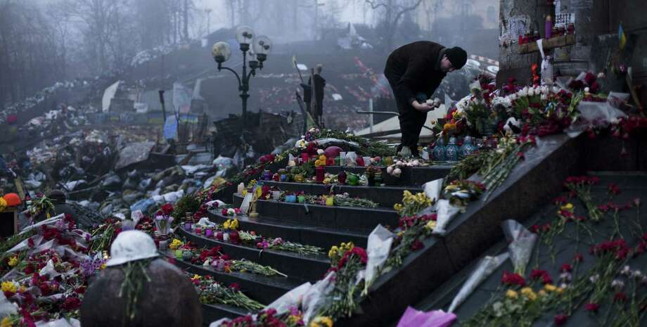 As memorials to victims of February's clashes in Kiev, Ukraine, continue to be laid, moves by the Kremlin signaled Russia was prepared to annex Crimea, further threatening peace in the region. Photo: David Azia / Associated Press / AP