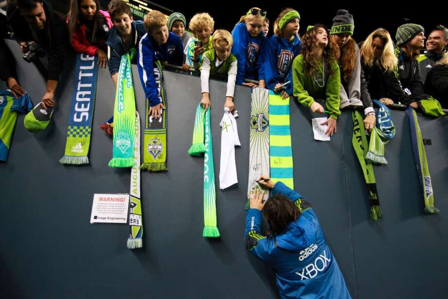 You know you're a Sounders fan if ...  ... the only scarves you own are green and blue. Photo: Sofia Jaramillo, Seattlepi.com