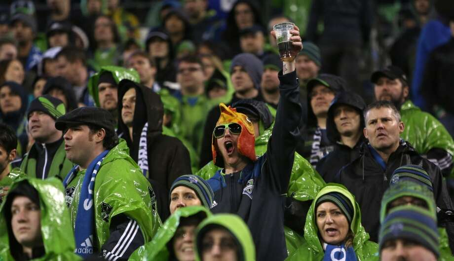 """You know you're a Sounders fan if ...... you ask your """"mates"""" if they want to """"grab a pint"""" and watch the match """"on telly."""" Photo: Joshua Trujillo, Seattlepi.com"""