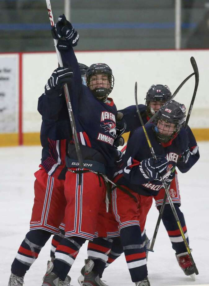 New Fairfield / Immaculate's #13 Joseph Hicks celebrates with teammates after scoring the first goal of the game against Newtown High School at Friday evening's SWC/ SCC Division 1 hockey championship.  New Fairfield / Immaculate would win 2-1. Photo: Mike Ross / Mike Ross Connecticut Post freelance -www.mikerossphoto.com