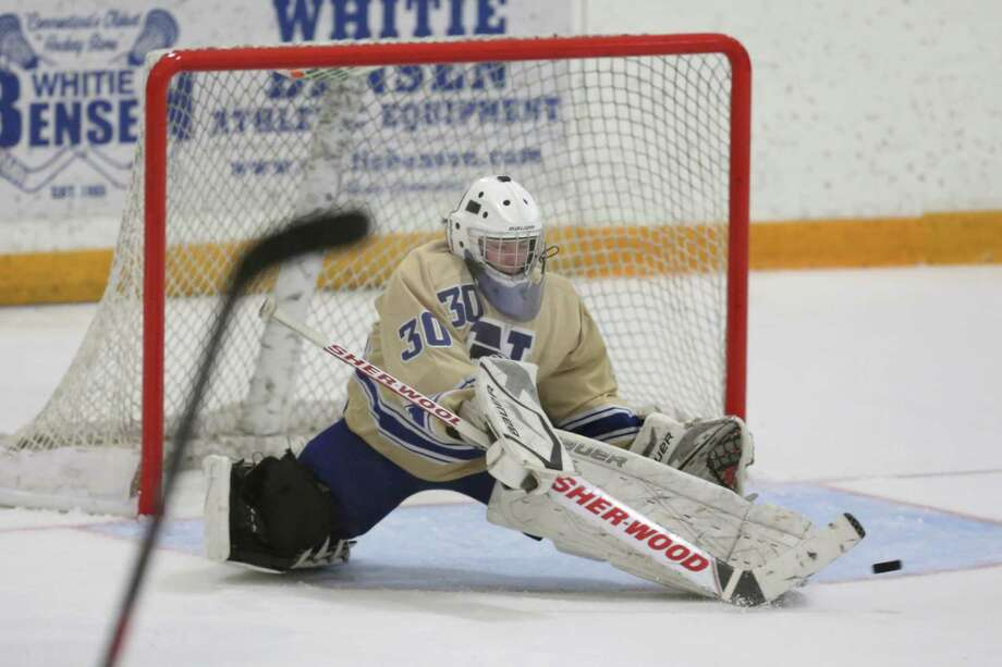 Newtown High School's goalie #30 Patrick McLaughlin makes a svae on goal during Friday evening's SWC/ SCC Division 1 hockey championship against New Fairfield / Immaculate .  New Fairfield / Immaculate would win 2-1. Photo: Mike Ross / Mike Ross Connecticut Post freelance -www.mikerossphoto.com