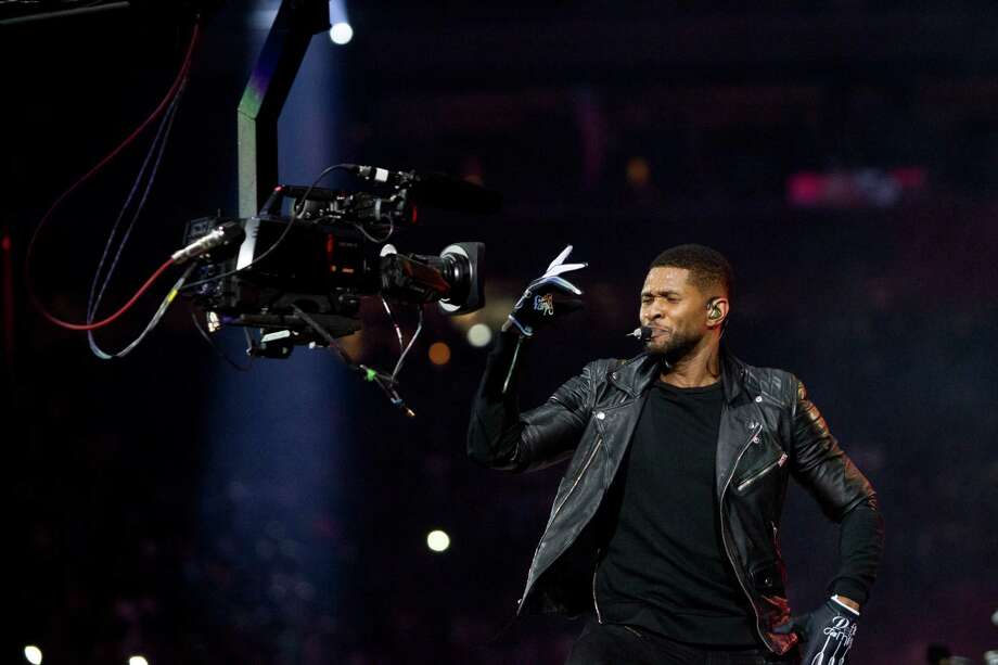 Usher performs at Reliant Stadium during the Houston Livestock Show and Rodeo, Friday, March 7, 2014, in Houston. Photo: Marie D. De Jesus, Houston Chronicle / © 2014 Houston Chronicle