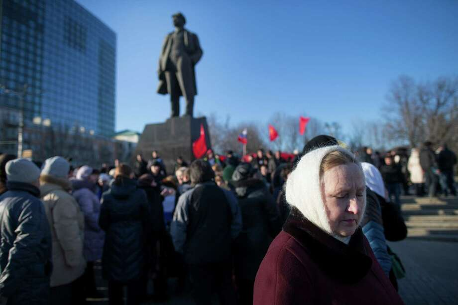 Pro-Russian protesters rally under Soviet flags flying by a statue of Vladimir Lenin at a central square in Donetsk, in the Eastern Ukraine, March 7, 2014. With attention focused on Crimean plans to secede from the Ukraine, separatist sentiment has been volatile in Donetsk as well, and twice this week Ukrainian police have evicted pro-Russian protesters who had stormed a regional administration building. (Uriel Sinai/The New York Times) ORG XMIT: XNYT22 Photo: URIEL SINAI / NYTNS