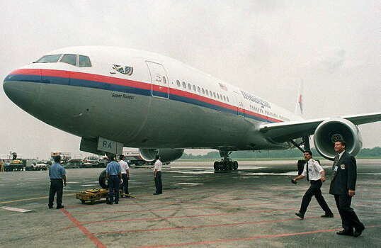 Malaysia Airlines officials said a Boeing 777-200, much like this one at Kuala Lumpur International Airport, carrying 239 people from Kuala Lumpur to Beijing went missing Saturday. Photo: FRANCIS SILVAN, Staff / AFP
