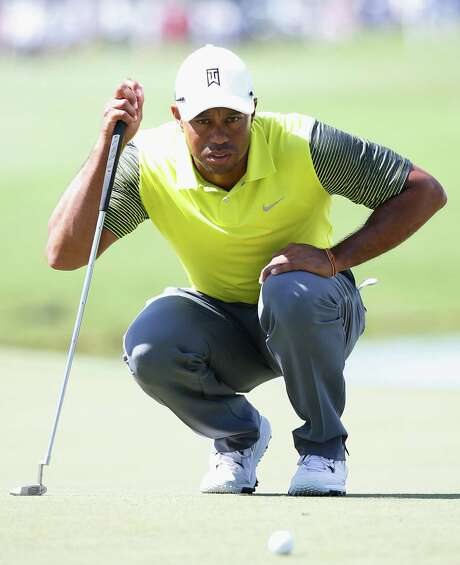 Tiger Woods managed to scrape out a 1-over 73, thanks to holing a 90-foot birdie putt on the par-3 fourth hole in the second round of the Cadillac Championship. Photo: Chris Trotman / Getty Images / 2014 Getty Images