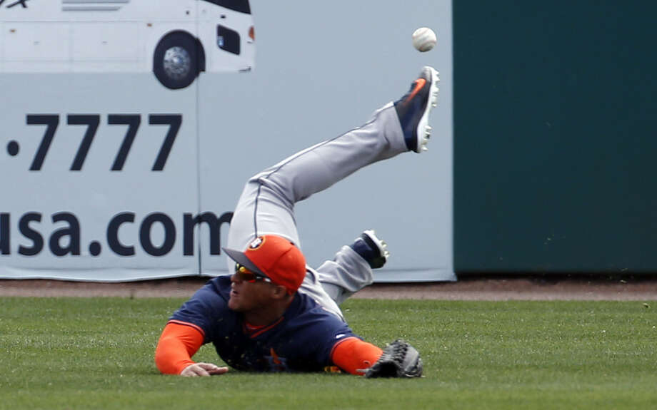 Astros right fielder George Springer can't catch Ian Desmond's hit during the Astros' 8-5 loss to the Nationals in Viera. Fla. Photo: Alex Brandon / Associated Press / AP
