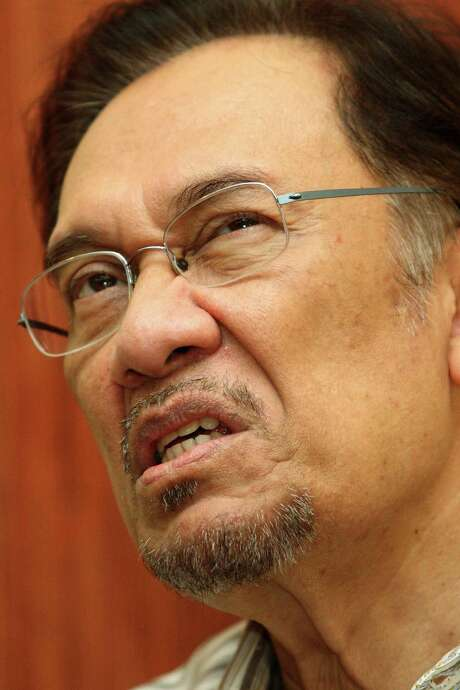 Malaysian opposition leader Anwar Ibrahim's acquittal for sodomy was overturned. / AFP