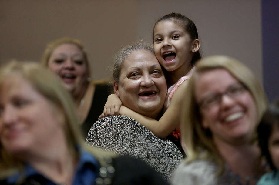 Linda Massiatte and Zarya Rodriguez, 5, (center) celebrate Rodriguez's adoption by Massiatte, her biological grandmother, during the monthly adoption ceremony in the Central Jury Room at the Bexar County Justice Center. Photo: Lisa Krantz / San Antonio Express-News / ©2013 San Antonio Express-News