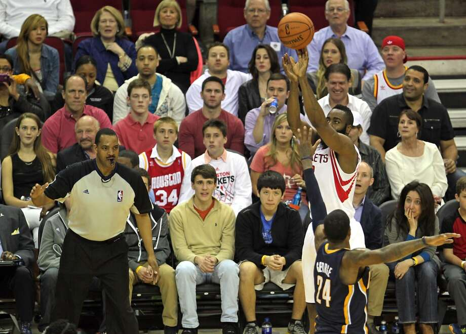 Rockets shooting guard James Harden makes a three-pointer. Photo: James Nielsen, Houston Chronicle