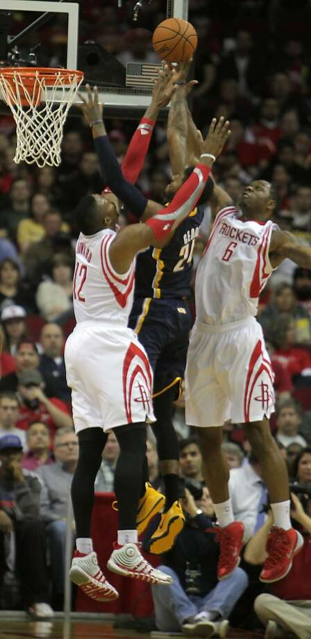 Rockets center Dwight Howard and Rockets power forward Terrence Jones double team Paul George. Photo: James Nielsen, Houston Chronicle