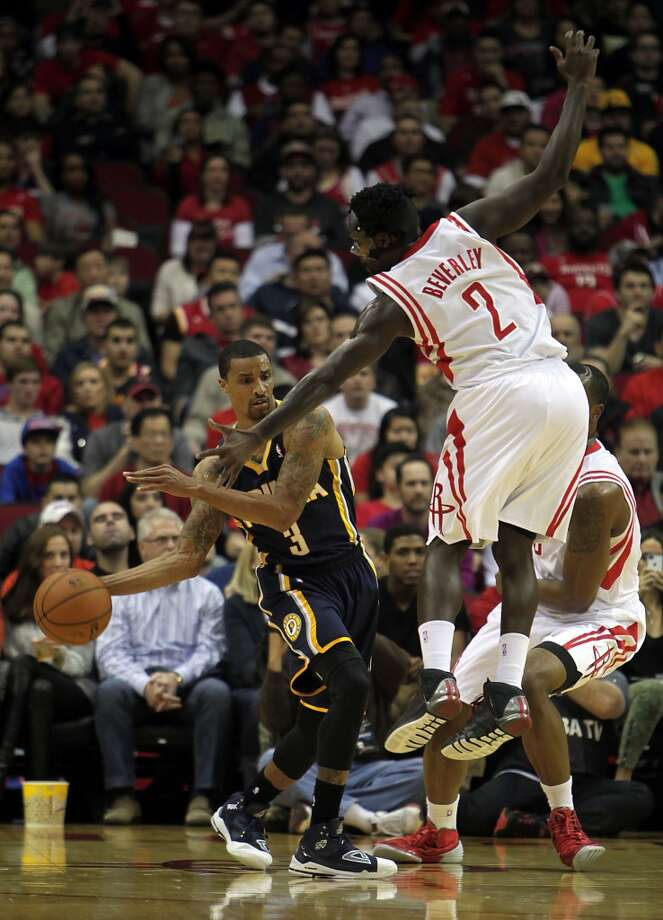 Pacers point guard George Hill passes the ball under Rockets point guard Patrick Beverley. Photo: James Nielsen, Houston Chronicle