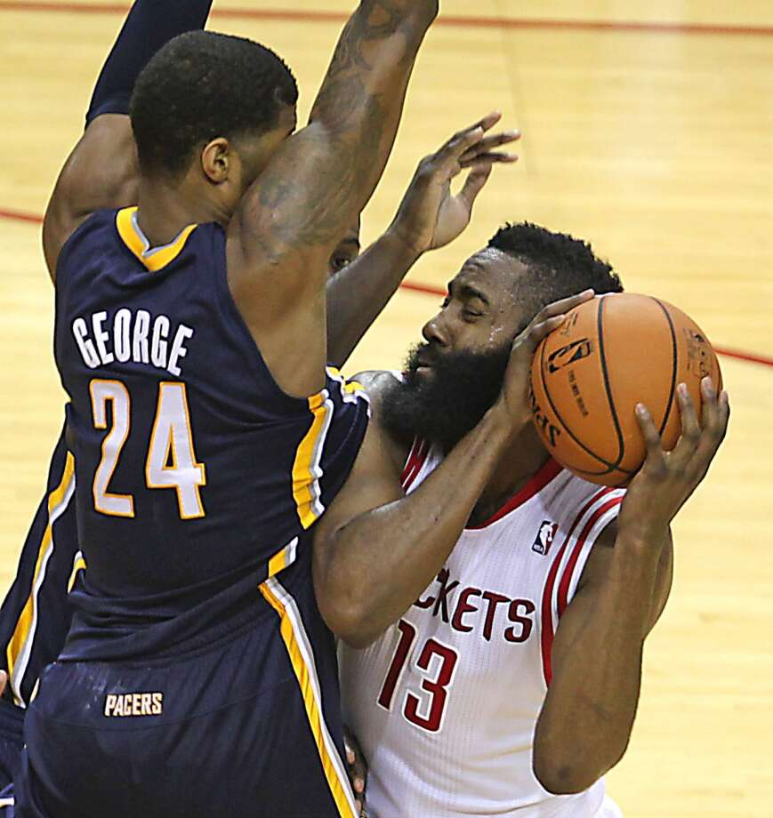 Pacers small forward Paul George collides into Rockets shooting guard James Harden. Photo: James Nielsen, Houston Chronicle
