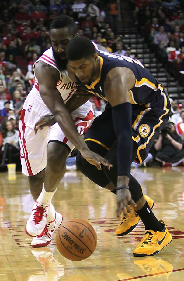 Rockets shooting guard James Harden left, and Pacers small forward Paul George right, chase a loose ball. Photo: James Nielsen, Houston Chronicle