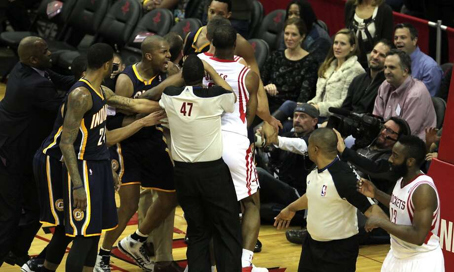 Pacers power forward David West, 2nd from right, is pulled away from Rockets players. Photo: James Nielsen, Houston Chronicle