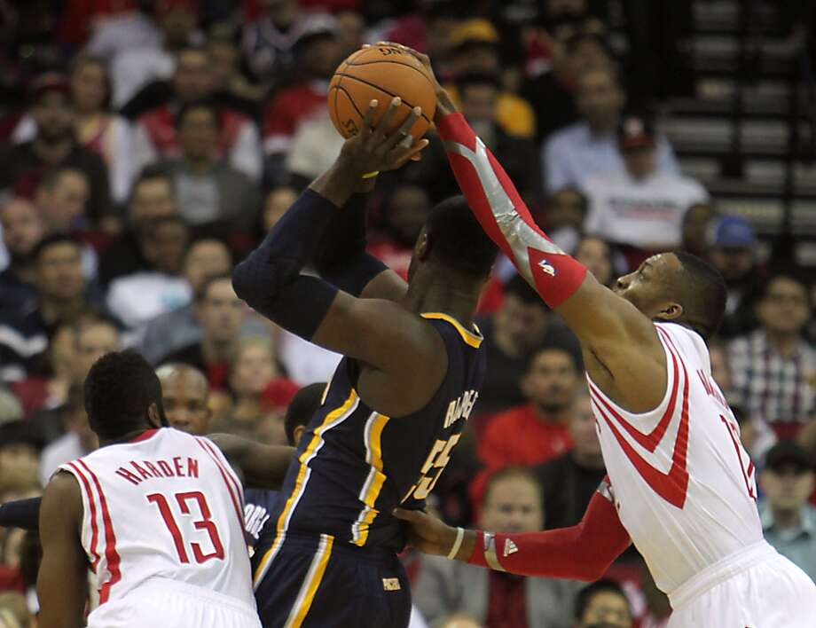 Rockets center Dwight Howard right, knocks the ball away from Pacers center Roy Hibbert. Photo: James Nielsen, Houston Chronicle