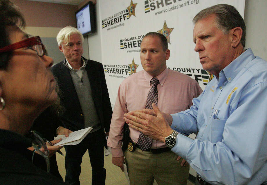 Volusia County Sheriff Ben Johnson , right,  with investigator Sgt. Richard Forton, center, talks with the media on Friday March 7, 2014 in Daytona Beach, Fla.  Ebony Wilkerson, 32, who drove a minivan carrying her three young children into the ocean surf off Florida,  faces attempted murder and other charges Friday, with authorities saying the children were screaming to bystanders that she was trying to kill them.  Wilkerson was placed in custody of the sheriff's office Friday after she had been hospitalized for a mental evaluation since Tuesday. Her children were with the Department of Children and Families. Wilkerson faces three counts each of attempted first-degree murder and aggravated child abuse, Johnson said. (AP Photo/The Daytona Beach News-Journal, David Tucker)    ORG XMIT: FLDAY103 Photo: David Tucker / The Daytona Beach News-Journal