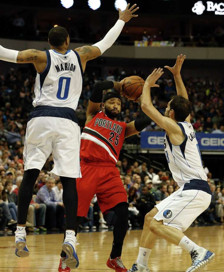 Shawn Marion and Jose Calderon cover Trail Blazers guard Mo Williams during the Mavericks' wild victory over Portland on Friday in Dallas. Photo: John F. Rhodes / Associated Press / FR170608 AP