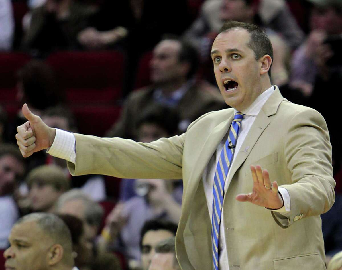 Indiana Pacers head coach Frank Vogel reacts on the side lines during the first quarter of NBA game action between the Indiana Pacers and the Houston Rockets at the Toyota Center Friday, March 7, 2014, in Houston.