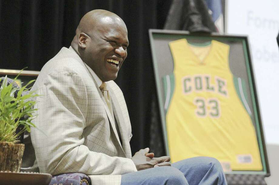 Shaquille O'Neal laughs during his jersey retirement ceremony Friday at Cole High School. O'Neal, who would go on to NBA stardom, led Cole to a 68-1 record and the 1989 3A state title. Photo: Kin Man Hui, San Antonio Express-News / ©2013 San Antonio Express-News