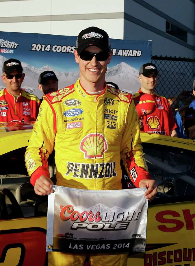 Joey Logano poses for photos after winning the pole position for Sunday'S NASCAR Sprint Cup Series auto race, Friday, March 7, 2014, in Las Vegas. (AP Photo/Isaac Brekken) ORG XMIT: NVIB107 Photo: Isaac Brekken / FR159466 AP