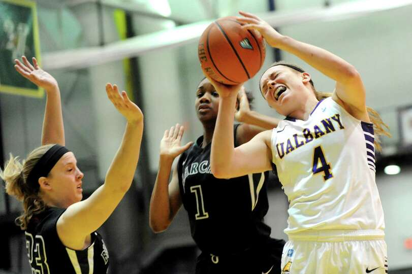 UAlbany's Sarah Royals, right, gets stopped short of the hoop by Binghamton's Kim Albrecht, left, an
